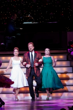 "(From left) Annie Fitch, Wess Cooke, and Madison Paige Buck sing ""It's Beginning to Look A Lot Like Christmas"""