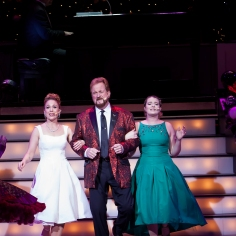"""(From left) Annie Fitch, Wess Cooke, and Madison Paige Buck sing """"It's Beginning to Look A Lot Like Christmas"""""""