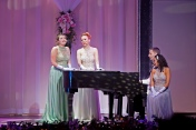 """(From left) Madison Paige Buck, Annie Fitch, and Kalie Martin sing """"Home for the Holidays"""", accompanied by Ricky Howsare"""
