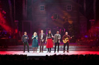 "Madison Paige Buck (second from left) and company sing ""Put A Little Holiday in Your Heart"""